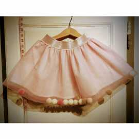 Pink sequined petticoat with pompoms
